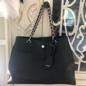 COACH black tote with double metal handles